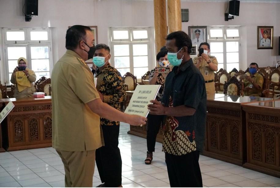 Lurah Kledung Karangdalem Hadiri Undangan Launching Bansos Bagi Warga Kelurahan